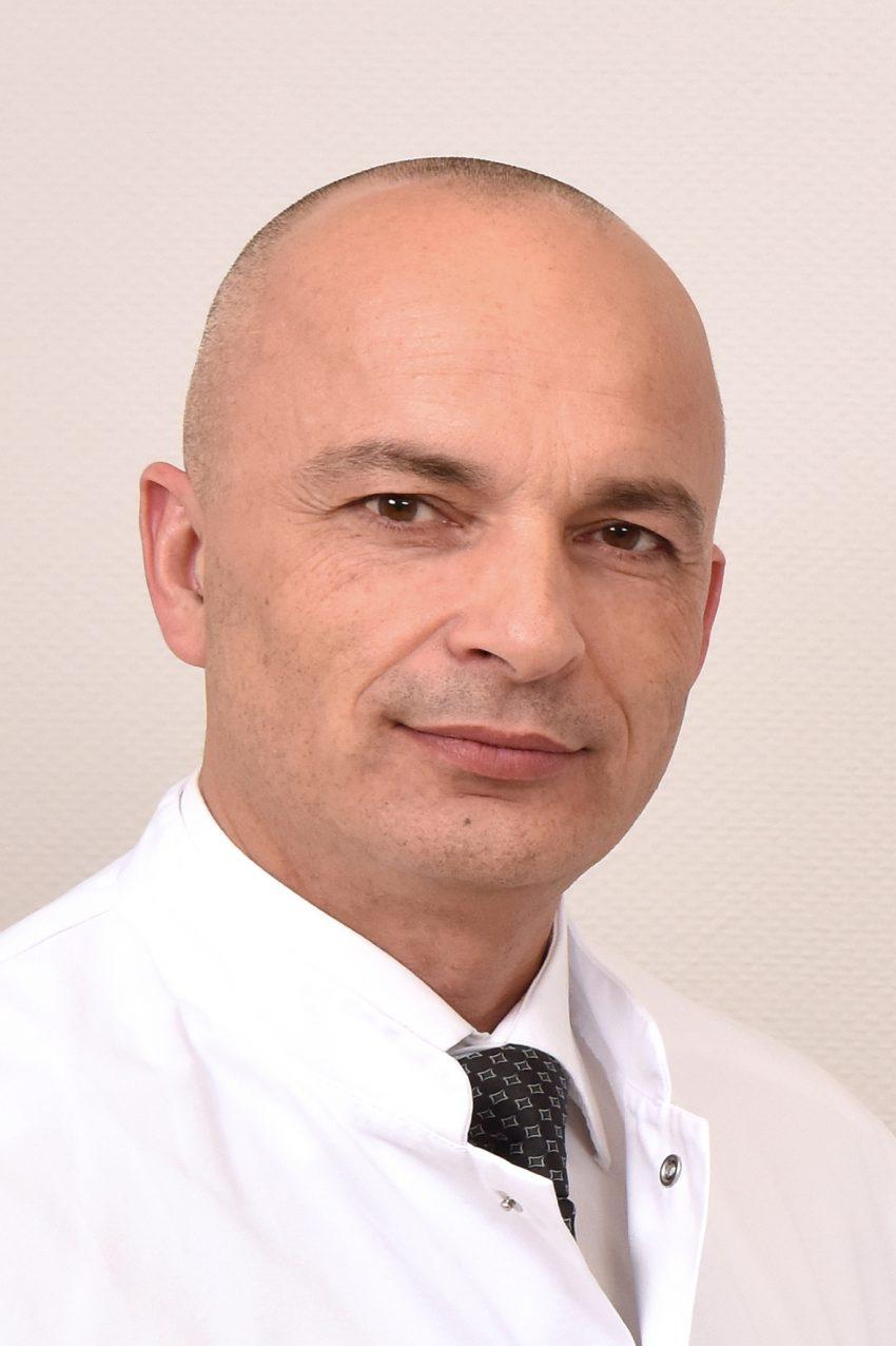 Dr. Erich Hecker.