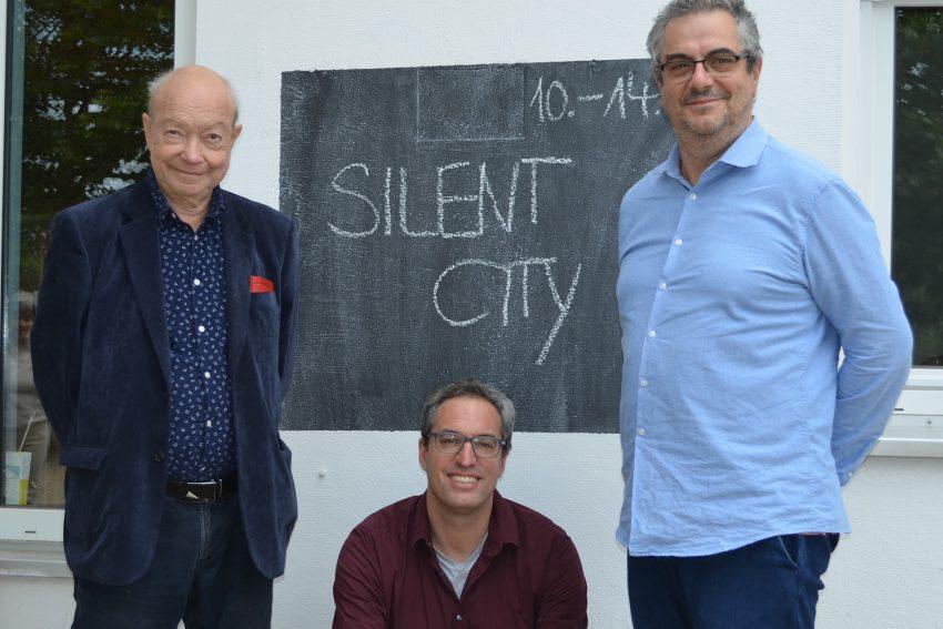 """Rolf Dennemann, Hans Dreher und Joao Garcia Moguel, die künstlerischen Leiter von """"Silent City""""."""